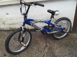 Blue bmx mongoose trick bike+helmet for Sale in College Park, GA