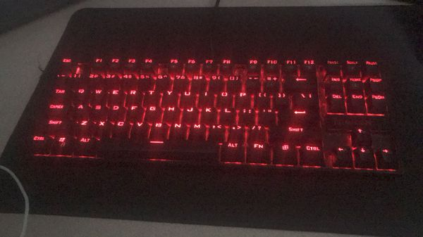 Logitech G502 gaming mouse and red dragon blue switch mechanical keyboard