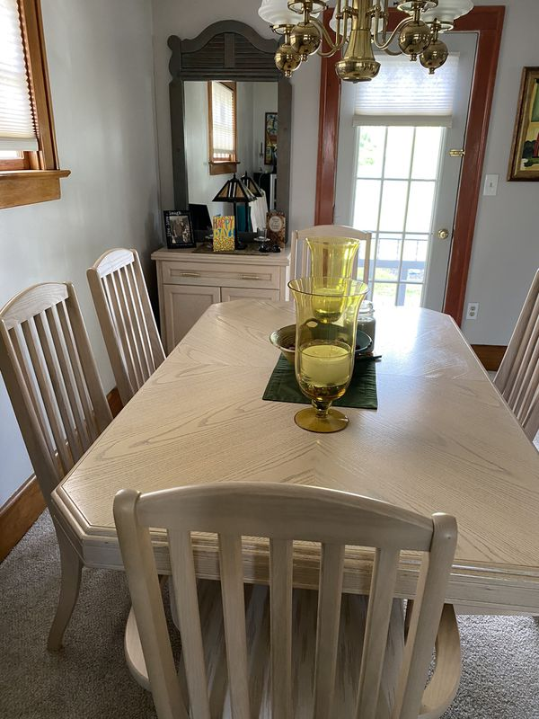 Dining table with six chairs china cabinet and small hutch