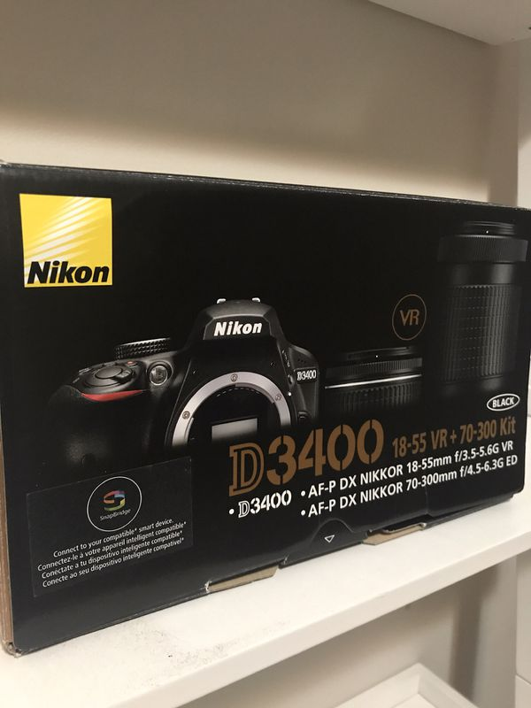 Nikon D 3400 with lens' and SD card