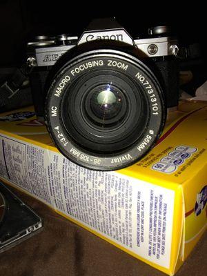 Ae-1 canon camera with 35 105mm vivitar macro focus lence for Sale in Phoenix, AZ
