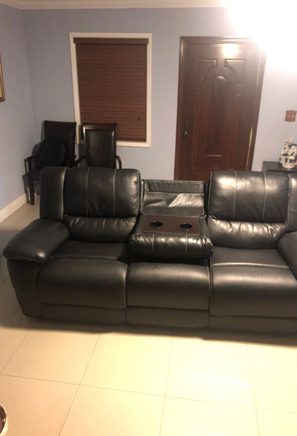 Black reclining couch in good condition