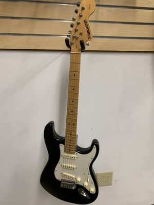 Squier Stratocaster CX electric guitar with case for Sale in Raleigh, NC