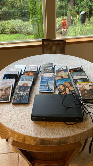 DVD player and 29 DVD's for Sale in Maple Valley, WA