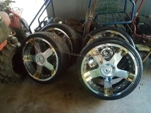 I have a pair of 22 inch rims and tires and I have a pair of 26 inch rims and tires for sale for Sale in El Dorado, AR