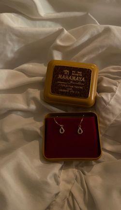 Gold diamond dangly earrings for Sale in Brentwood,  TN