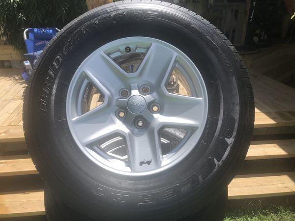 5 (Four + spare) Bridgestone Dueler H/T 245/75R17 Tires on 2020 Jeep Gladiator Alloys 17in x 7.5