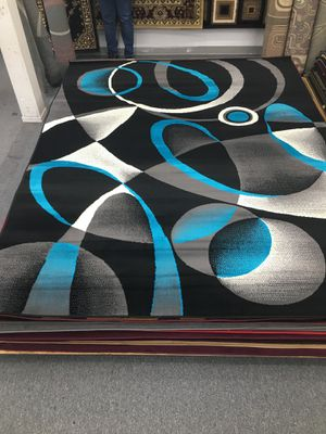 Brand new big size area rug black and blue colors for Sale in Salem, OR