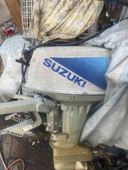 Boat motor 15 hp suzuki runs 2stroke. Need a lil tlc $300 for Sale in Whitman,  MA