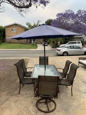 Wicker glass outdoor patio lawn dining table with 6 chairs and umbrella hole for Sale in San Diego, CA