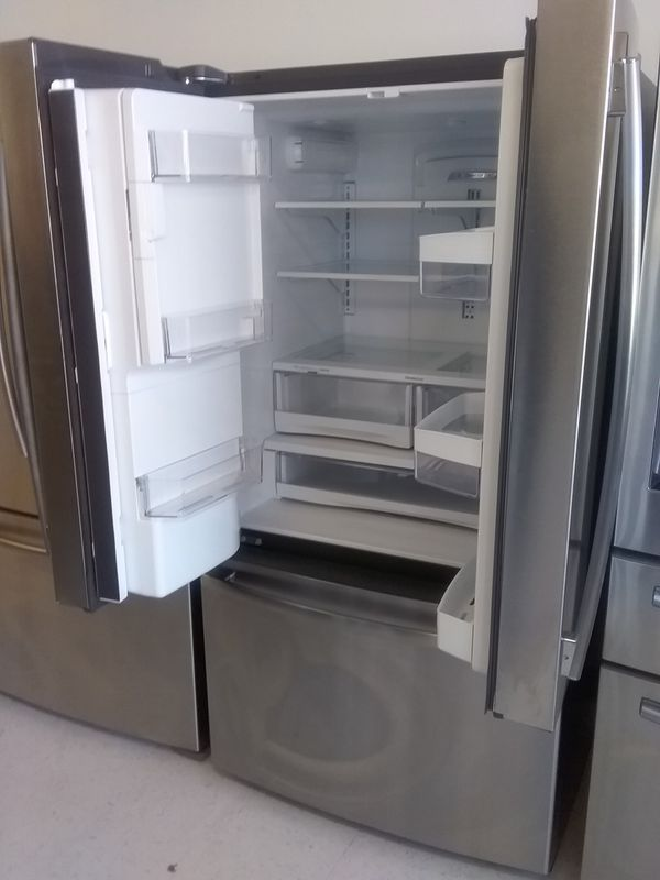 Ge french doors stainless steel refrigerator used good condition 90 days warranty