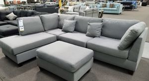 Grey sectional sofa with ottoman new in box for Sale in Downey, CA