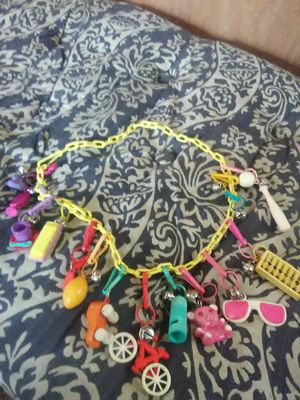 Vintage 1980s charm necklace with 13 charms for Sale in Traskwood, AR
