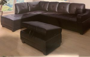Black leather sectional couch and ottoman for Sale in Fall City, WA