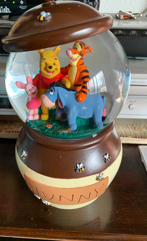 Two Disney snow globes new still in box . Musical. Winnie the Pooh. $30. And Dory. Is $20 for Sale in Sacramento, CA