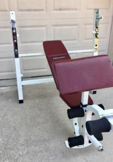 Olympic weight bench w/ preacher curl , leg curl , leg extension , adjustable bar height ( 4 settings) adjustable bench for Sale in Murphy, TX
