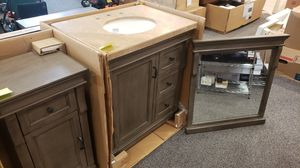 Beautiful distressed gray 30 inch vanity cabinet with travertine stone top for Sale in Coppell, TX