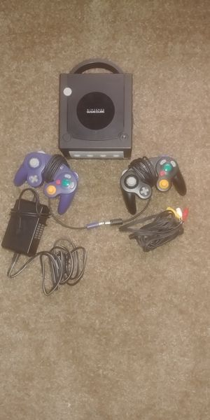 Nintendo GameCube with 2 controllers, Cables, Super Smash Bros., and Madden 06. for Sale in Houston, TX
