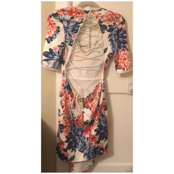 Floral asymmetrical dress with front slit.
