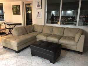 Beige sectional leather couch with brown ottoman. for Sale in Miami Beach, FL