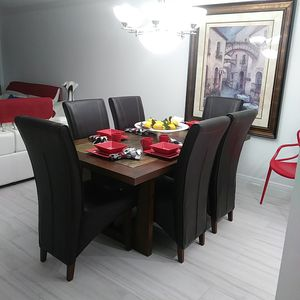 Solid oak dining room table and leather chairs for Sale in Pompano Beach, FL