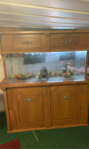 180 gal fish tank with hand maid stand and top all cherry wood beautiful tank one of a kind must see price is very firm no lower for Sale in Millington, MI
