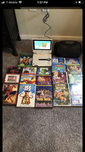 Portable DVD player with 18 kids DVDs Comes with charger/car charger and carrying case for Sale in Mill Creek, WA