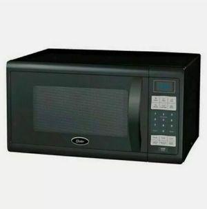 Oster 1.1 Cu-Ft. 1100 Watt Digital Microwave Oven-Black OGZJ1104 for Sale in Richmond, VA