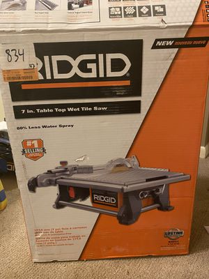 "Ridgid 7"" Table Top Wet Tile Saw - like new + RYOBI submersible pump for tile saw for Sale in Alamo Heights, TX"