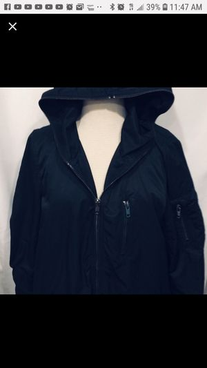 Divided Black parka w/blue lining. Hooded/ Winter warm & dry. 4 pockets outside. 1 pocket inside. Nice fit not bulky for Sale in Tustin, CA