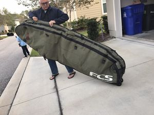 FCS surfboard bag with wheels for Sale in Ponte Vedra Beach, FL