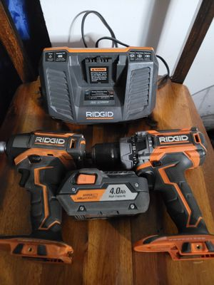 Ridgid hammer drill, impact, battery, charger, and bag for Sale in Orlando, FL