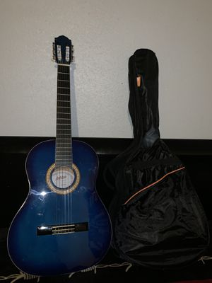 Blue acoustic guitar with bag for Sale in Fort Worth, TX