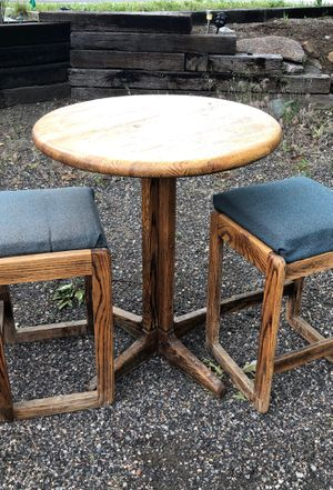 Round oak table with two matching stools for Sale in Arvada, CO