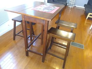Drop leaf high table with 2 high stools included. Strong sturdy. Brown wood. for Sale in Jersey City, NJ