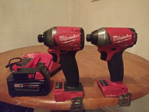 2 Milwaukee M18 fuel impact drivers + battery and charger for Sale in Arlington Heights, IL