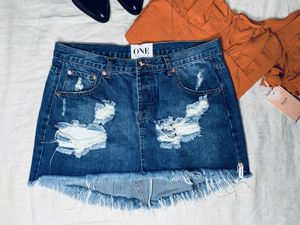 One Teaspoon denim fringe distressed skirt. Please note this item is gently worn. Measurements are approximate Waist 16.5 inches Hips 18.5 inches L for Sale in Hollywood, FL