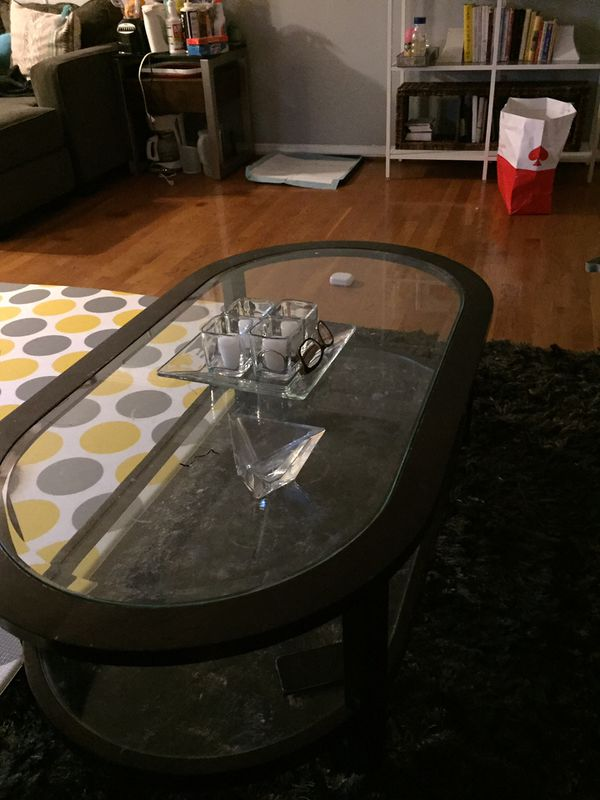 Coffee table. Solid wood. Has some scratches Had it for years. Kept it because of the glass table top reflects the light well.