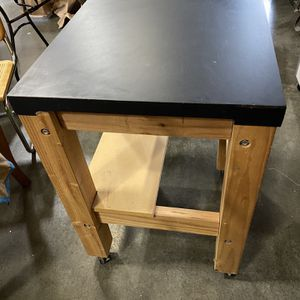 Heavy duty rolling shop table w/ locking wheels and storage shelf for Sale in Puyallup, WA