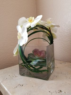 Phaleanopsis orchids, succulent and grass in our glass plate vases. for Sale in Las Vegas, NV