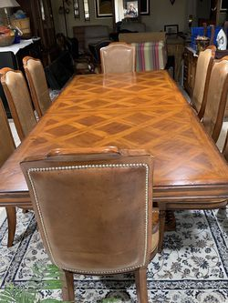 Hard Solid Wood Dining Table With One Leaf And 8 Real Leather Chairs Excellent Condition High Quality Table for Sale in Henderson,  NV