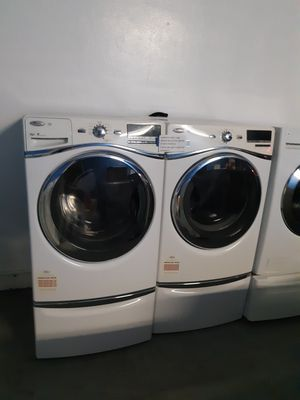 WHIRLPOOL FRONT LOAD WASHER AND DRYER SET WITH PEDESTAL WORKING PERFECTLY W/4 MONTHS WARRANTY for Sale in Baltimore, MD