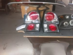 1996 Honda accord set of headlights an the back wing break light for Sale in Las Vegas, NV