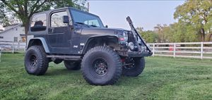 2000 Jeep Wrangler TJ 6 cylinder 4.0L 4WD for Sale in Rio Linda, CA