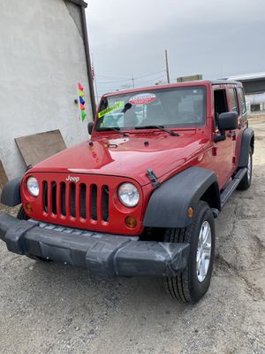 2009 Jeep Wrangler six-cylinder automatic 4 x 4 for Sale in Malden, MA