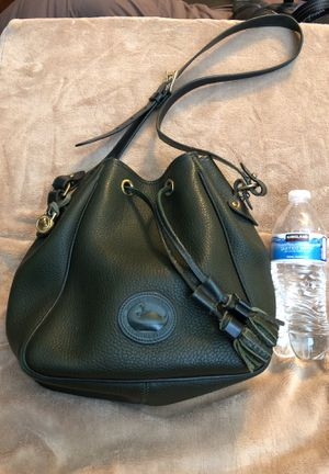 All Weather Leather Dooney and Bourke Tassel Bag for Sale in Sun City, AZ