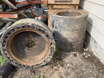 Skid steer bobcat solid tires like foam filled for Sale in Seattle,  WA