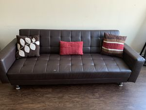Collapse-able leather couch turns into futon (2 piece) for Sale in Silver Spring, MD