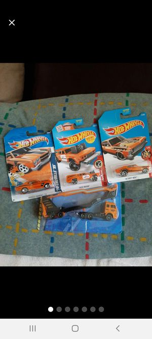 Hot Wheels 3 Orange Cars & Car-Carrier for Sale in Williamsport, PA