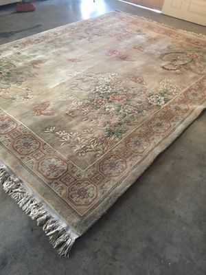 Big rug used it was expensive has many cuts needs to clean and fix 8by10 u can use it in the garage to set on for Sale in West Covina, CA